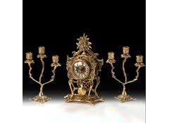 Часы дизайнерские каминные с маятником и канделябрами